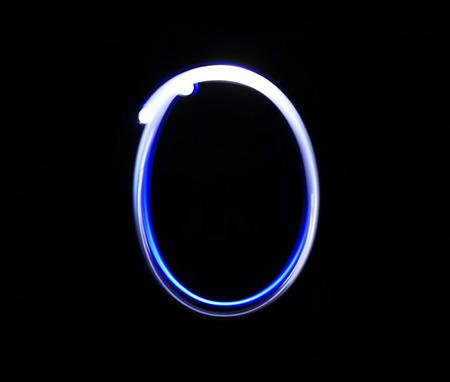 oscar: O Oscar alphabet hand writing blue light  over black background.