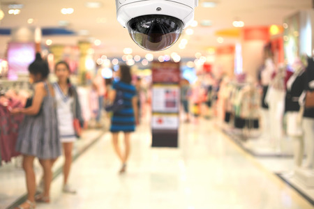 private security: CCTV camera spy on the shopping mall.