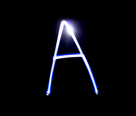 created: A Able alphabet hand writing blue light  over black background.