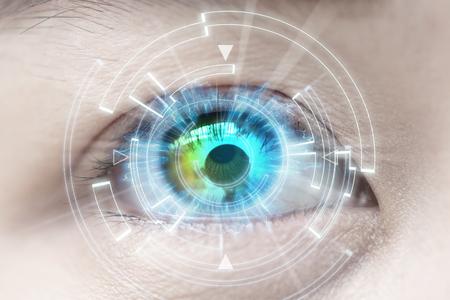 Close-up of woman's blue eye. High Technologies, contact lens, cataract