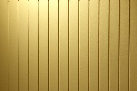 Pared de madera de oro en la textura de fondo. Foto de archivo - 51552423