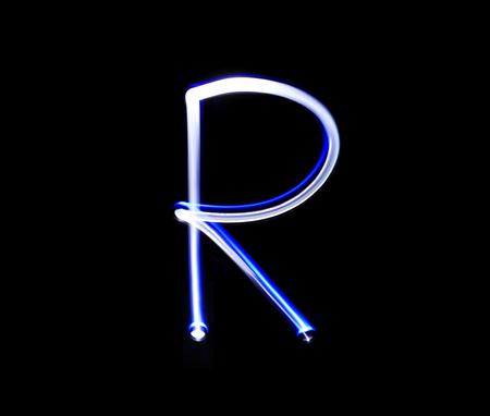 fire letter: R Romeo alphabet hand writing blue light  over black background.