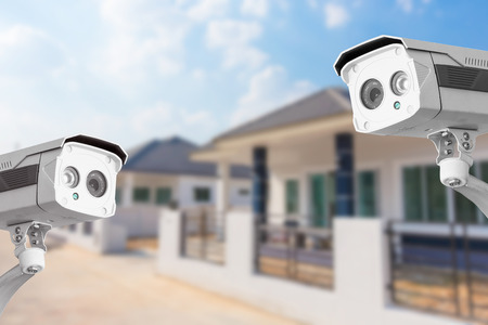 security alarm: CCTV Home camera security operating at house.