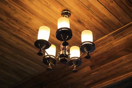 vintage chandelier: Vintage chandelier hanging on ceiling wooden.