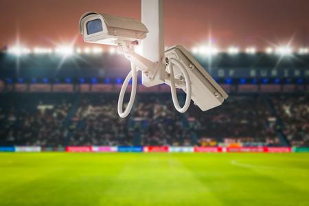 CCTV security in stadium football at twilight background.