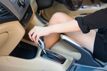 shifting: Hand driver shifting gear stick before driving car.
