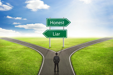 honest: Businessman concept, Sign Honest or Liar road to the correct way.