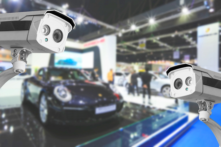 show room: CCTV camera of commercial cars in show room. Stock Photo