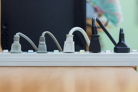 energized: Electrical appliances pluged, several adapter and charger.