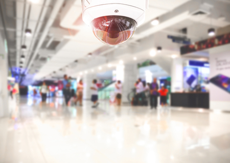 clothing stores: CCTV Security camera shopping department store on background.