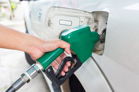 fill up: Man fill up fuel at a gas station.