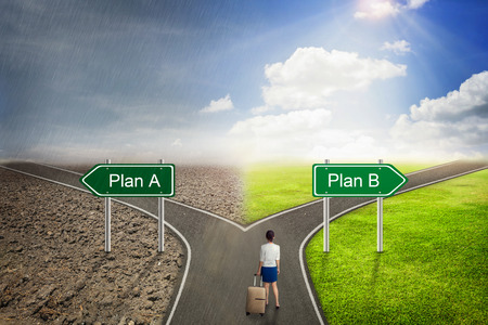 between: Businessman concept, Plan A or B road to the correct way.
