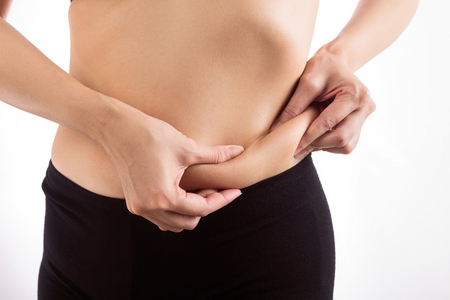 pinching: Body woman pinching on her stomach. Stock Photo