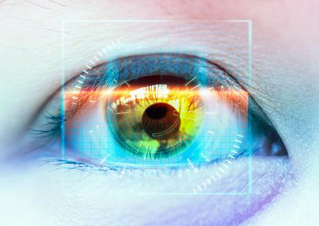 カラフルな目のクローズ アップ。未来をスキャンします。高度な技術 写真素材