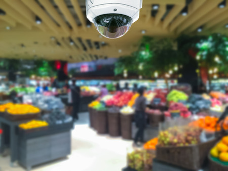 CCTV camera security in shopping mall with supermarket blur background. Stockfoto