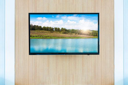 Black LED tv television screen mockup. Landscape on monitor Stock Photo