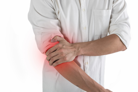 Close-up on business man with wrist pain.