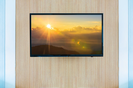 tv screen: Black LED tv television screen mockup. Landscape on monitor Stock Photo