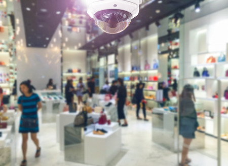 CCTV security camera on shopping department store.