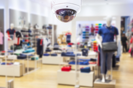 CCTV CCTV centro commerciale centro di fondo su sfondo sfocato. eps10 Archivio Fotografico - 77440116