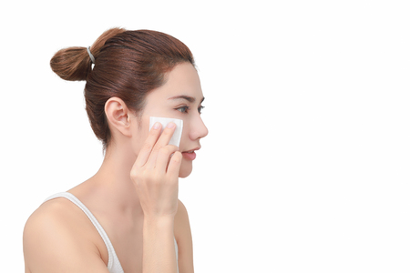 Skin care concept. Woman removing makeup from her face. with clipping path Фото со стока