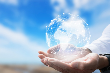 Businessman holding in hand with global connection concept. Banque d'images