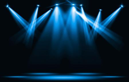 舞台照明。暗闇の中を青いスポット ライト ストライク。 写真素材