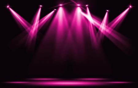 Stage lights. Pink violet spotlight strike through the darkness.