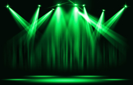 Stage lights. Green spotlight with certain through the darkness. Stock Photo