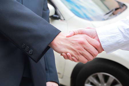 close up of male handshake in auto show or salon. Stockfoto