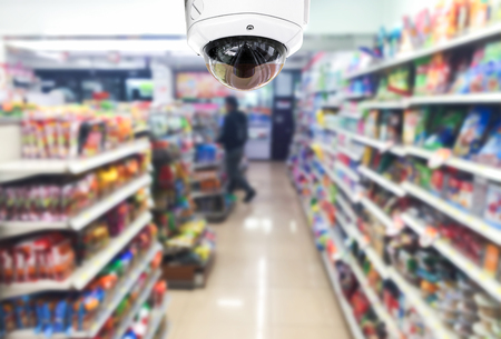 CCTV on shop supermarket on blurry background.