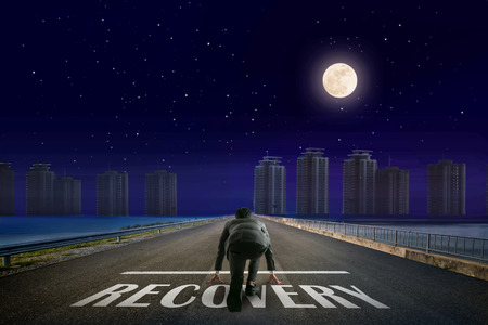 Businessman RECOVERY line in front of city. Night back view. Elements of this image furnished by NASA.