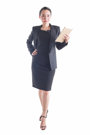 Business woman holding tablet computer isolated on white background.