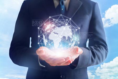 Businessman in hands touching digital global network.