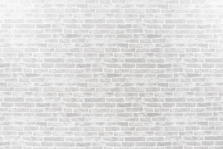 Abstract weathered textured on white brick wall background. Stock Photo