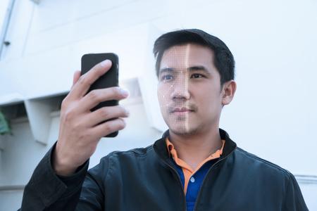 Biometric facial recognition on smartphone. Unlock smartphone as it scans his face. Foto de archivo