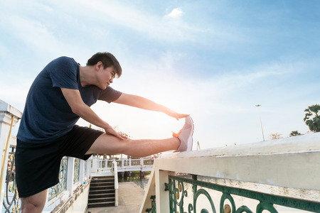 Young man runner stretching and exercise healthy lifestyle. Stock Photo