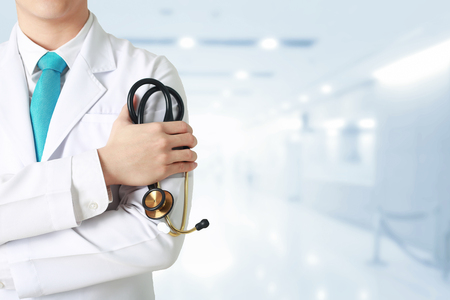 Doctor leading a medical at the blurry hospital background.