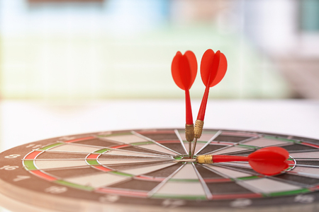 Circular target marked with dart with defocused or blurred bokeh background.