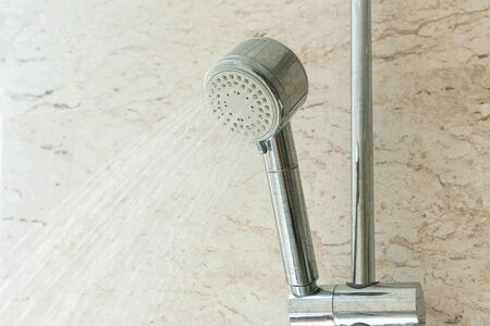 Close up of water shower faucet in the bathroom. Фото со стока