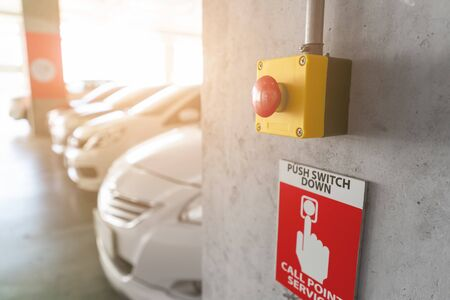 Emergency Alarm button at car park complex for security alert and crime control.