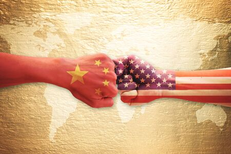 Two hands punch with China and USA flag over world map. Concept of trade war. Фото со стока