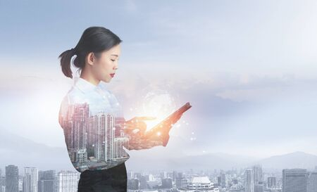 Attractive business lady working on tablet. Innovation technology concept