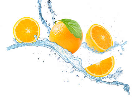 Orange juice splashing with fruits isolated on white background. Stockfoto