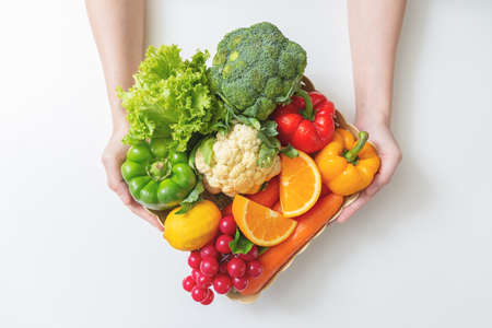 Closeup of  hands Woman with fresh vegetables in the box. top view Stockfoto