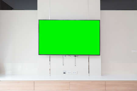 TV on the wall in modern living room. green screen