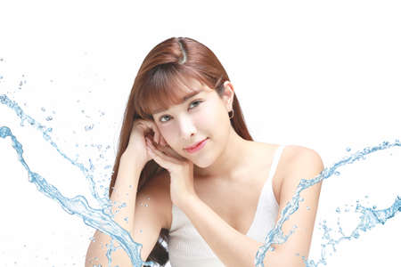 Asian Beautiful model. Beautiful Smiling girl under splash of water with fresh skin on white background. Stockfoto