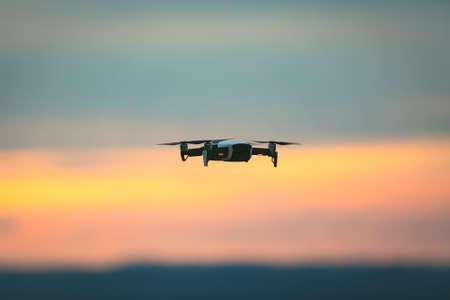 Drone pilotage on the sky at sunset. Stockfoto