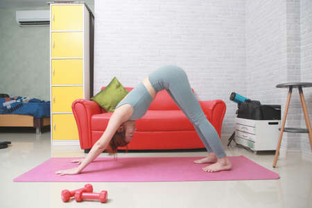 Woman practice yoga Downward yoga Adho Mukha Svanasana pose to meditation. Stockfoto