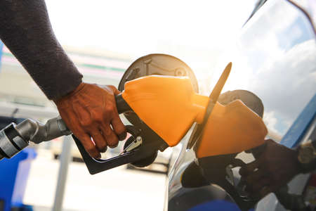 Close up of fuel monitoring system refueling a petroleum to vehicle at gas station. Stockfoto
